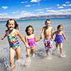 Kids having fun in the sea