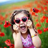 Little girl in a poppy field