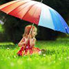 Portrait of little girl under umbrella in the sunshine
