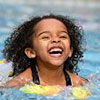 Portrait of girl having fun in the pool
